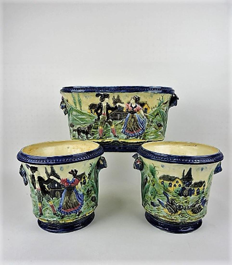 Majolica 3 pc jardiniere set with birds and people