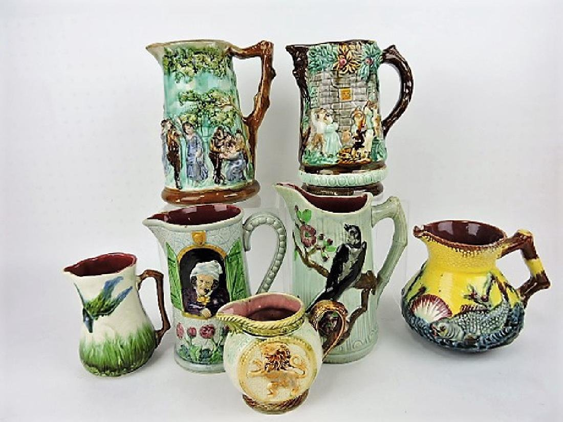 Majolica lot of 7 pitchers, various condition