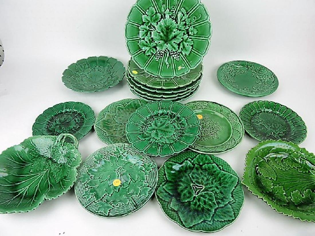 Majolica dark green lot of 17 plates and trays,
