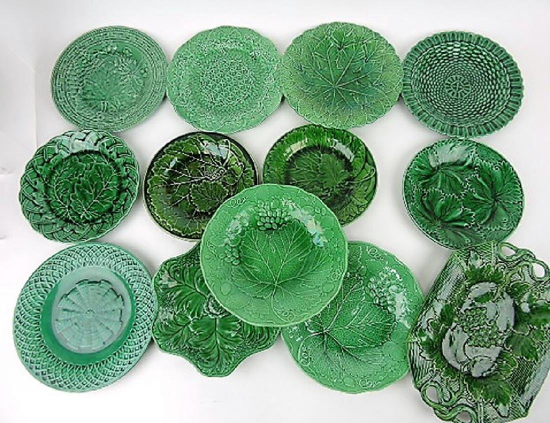 Majolica dark green lot of 13 plates and trays