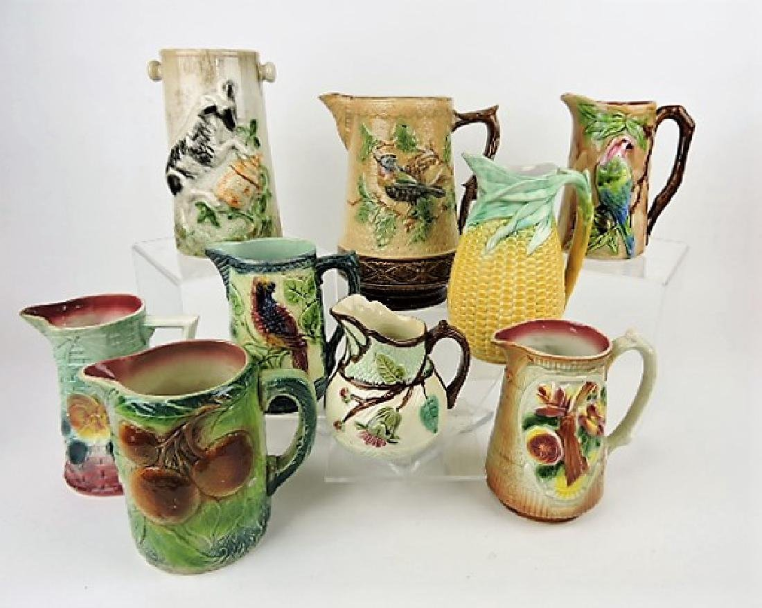 Majolica lot of 8 pitchers and one vase,