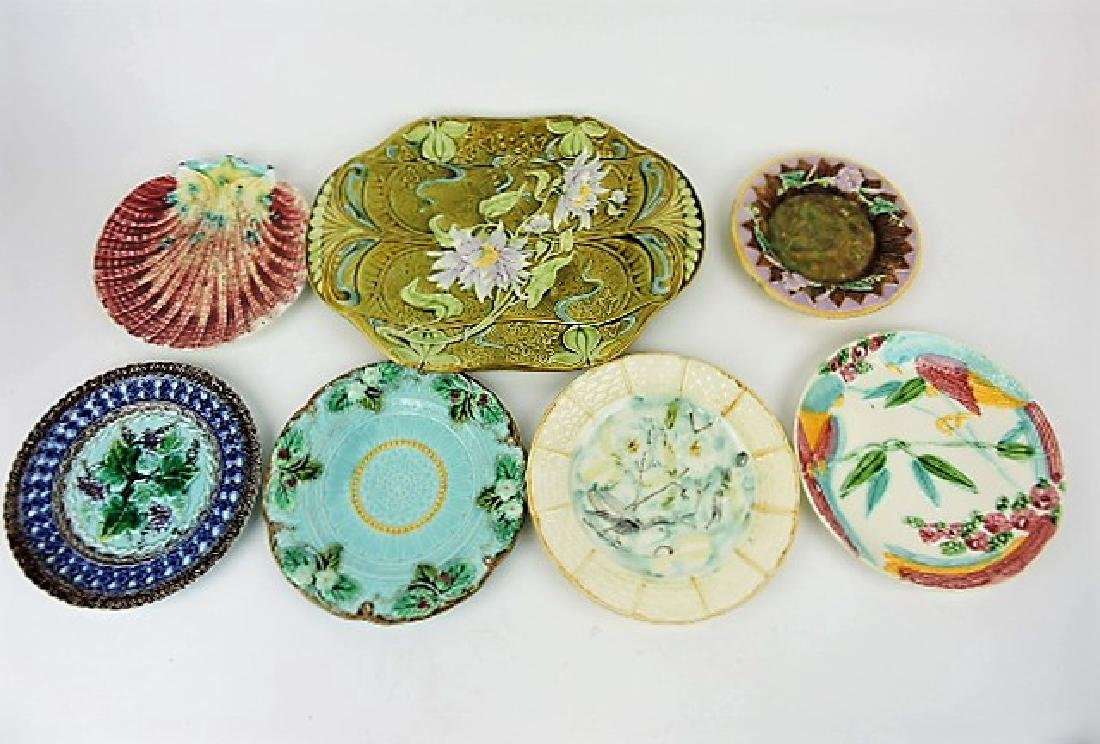 Majolica lot of 7 plates and platter, various