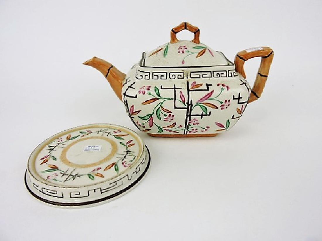 Brownhills Pottery majolica teapot and trivet