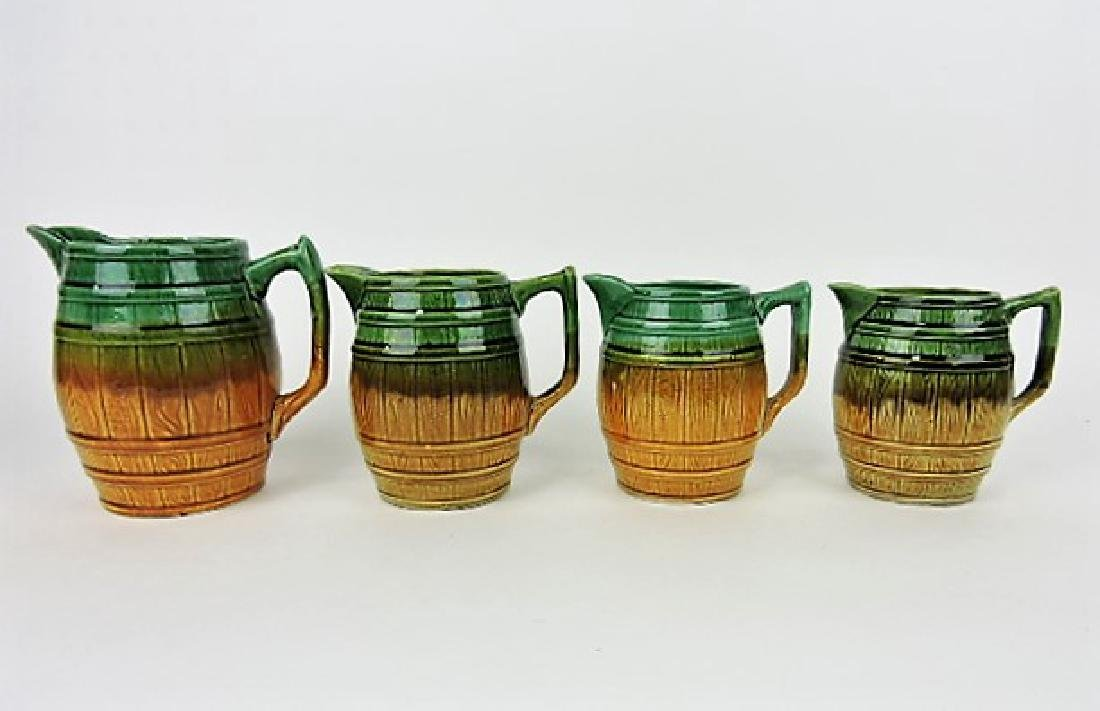 Majolica set of 4 graduated barrel pitchers,