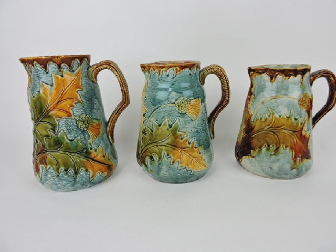 French majolica set of 3 graduated thistle jugs,