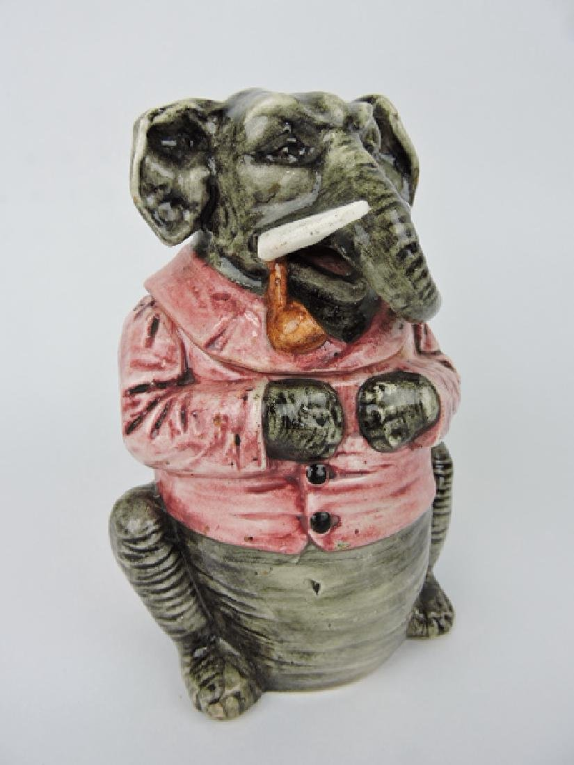 Majolica figural humidor of elephant with red