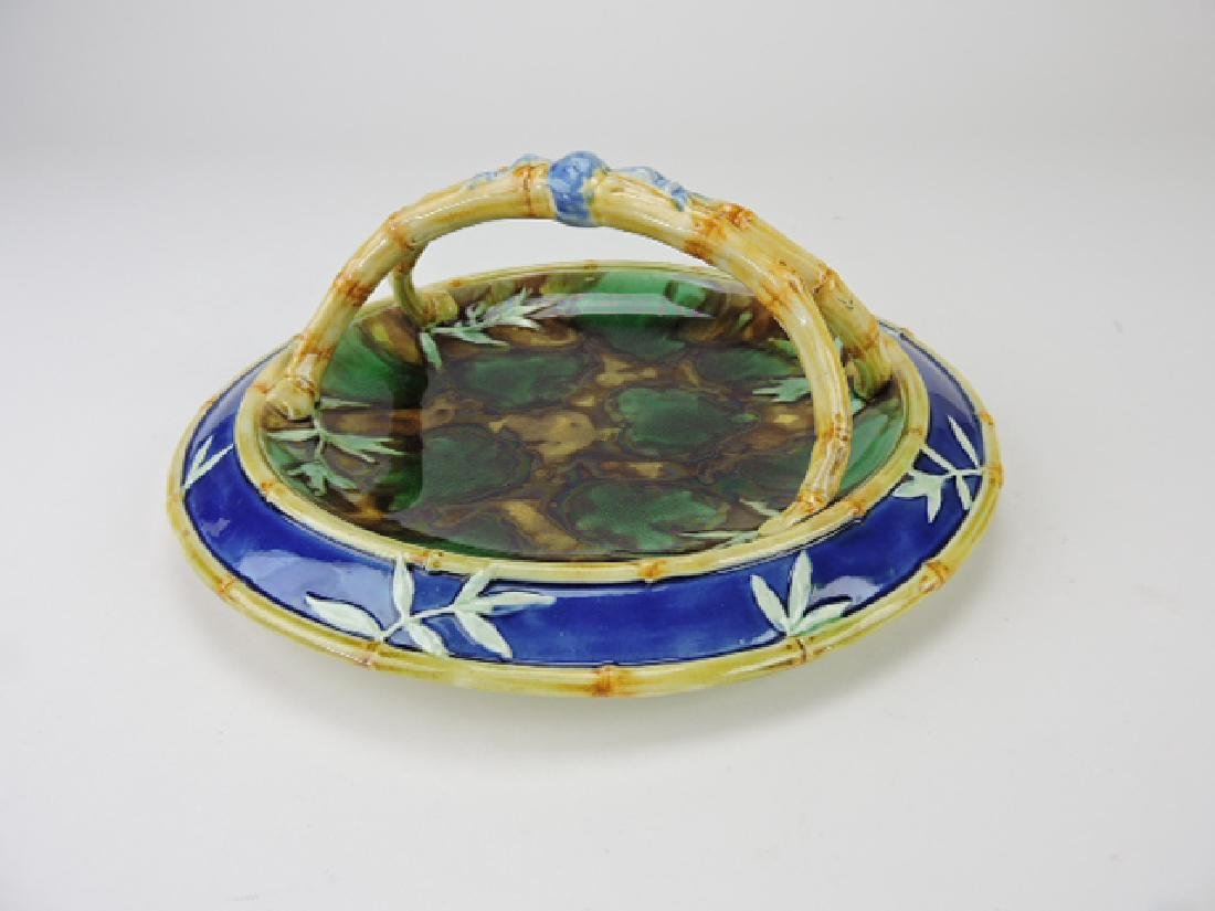 Wedgwood majolica basket with cobalt rim and
