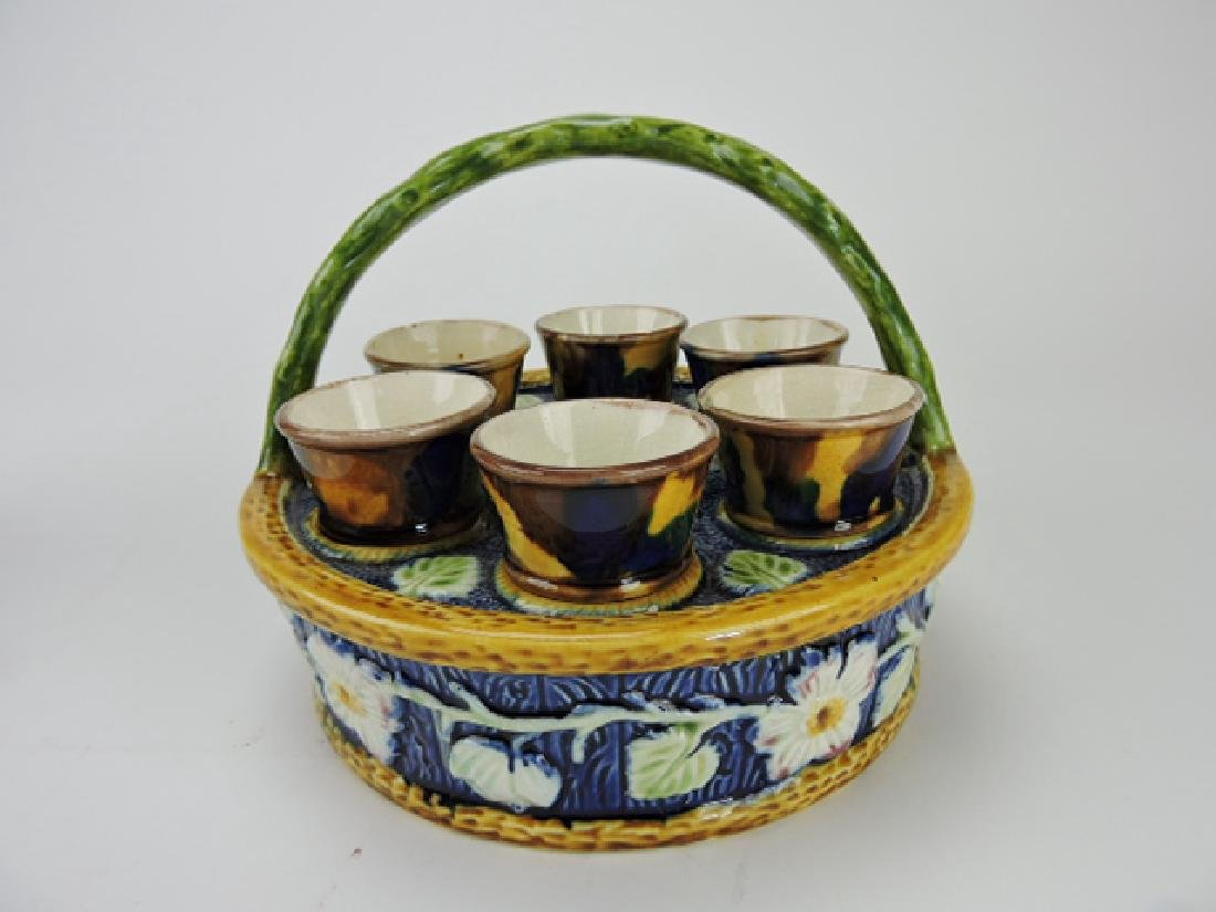 Majolica egg cup basket with 6 egg cups,