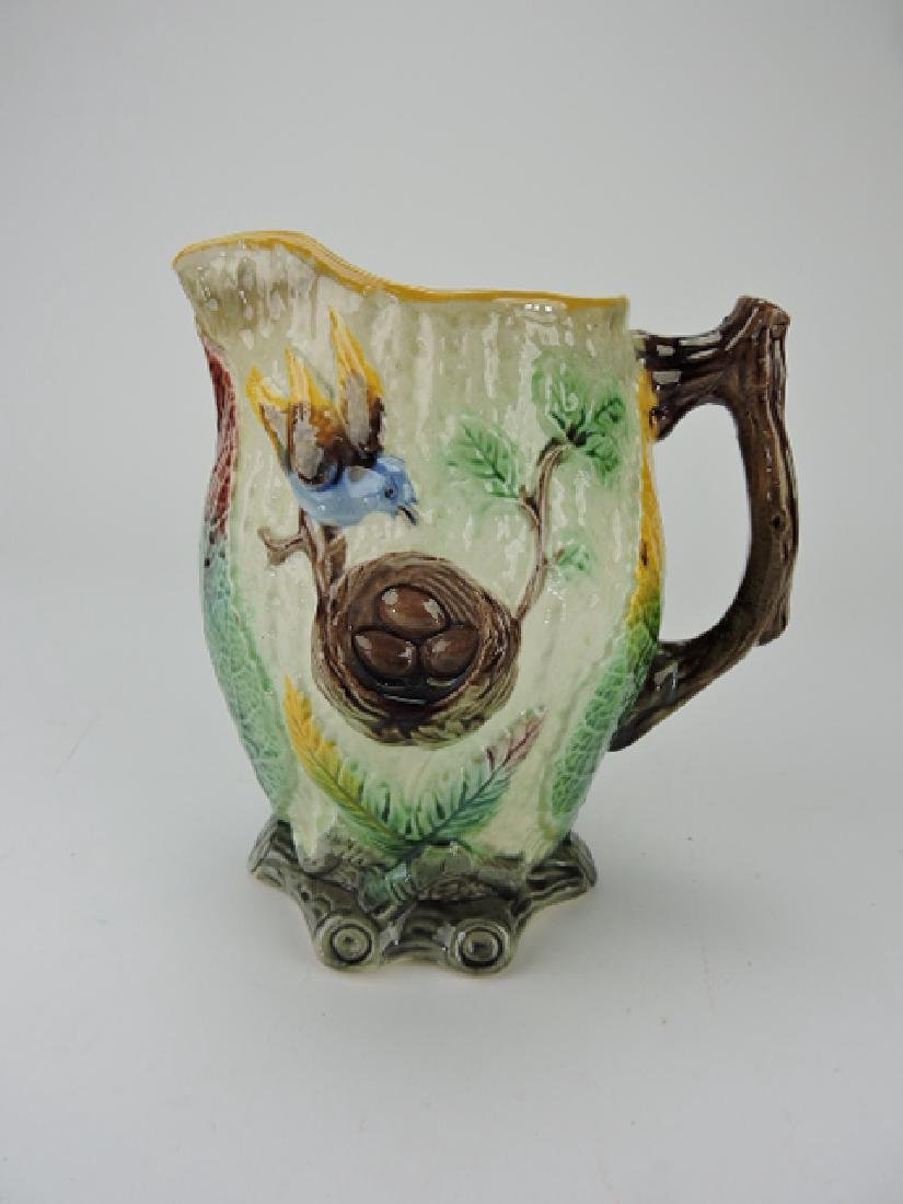 "Majolica bird and nest pitcher, 8 1/2"", staining"