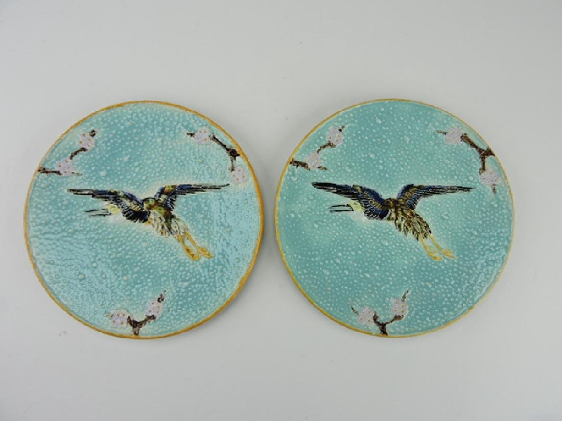Holdcroft majolica pair of flying crane plates,