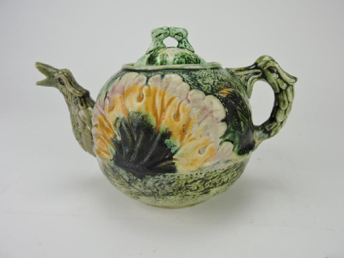 Tenuous (attributed) majolica teapot with bird