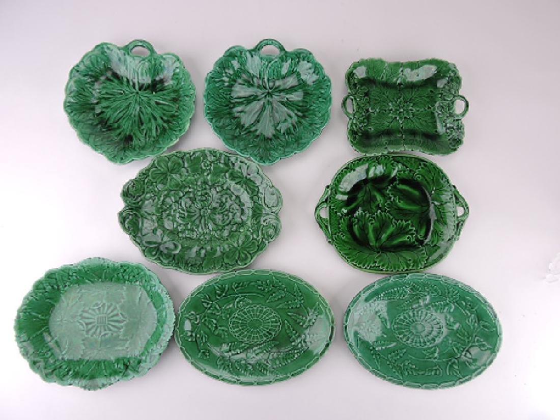 Dark green majolica lot of 8 trays and platters,