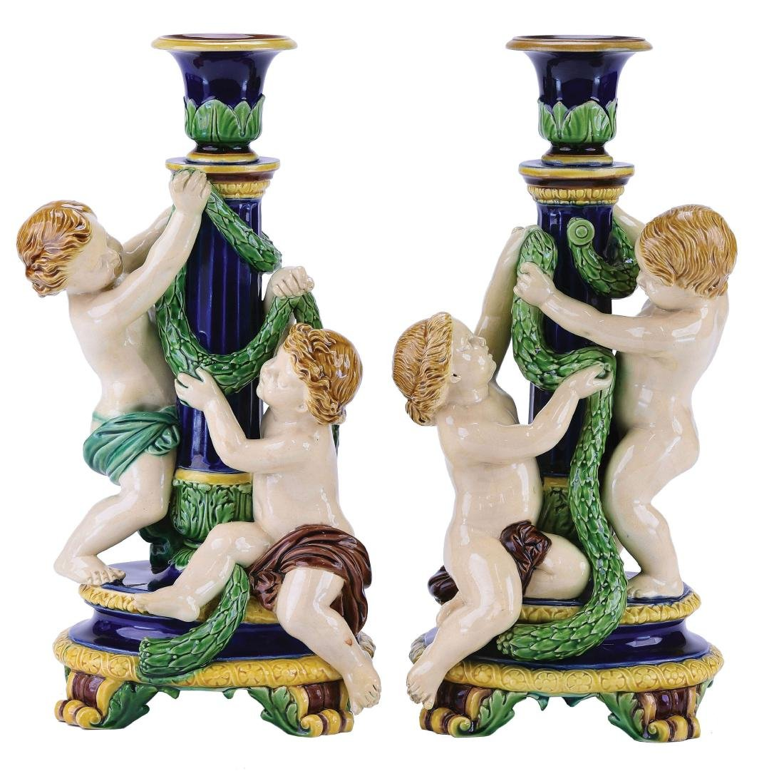 Rare Pair of Minton Majolica Putto Candlesticks