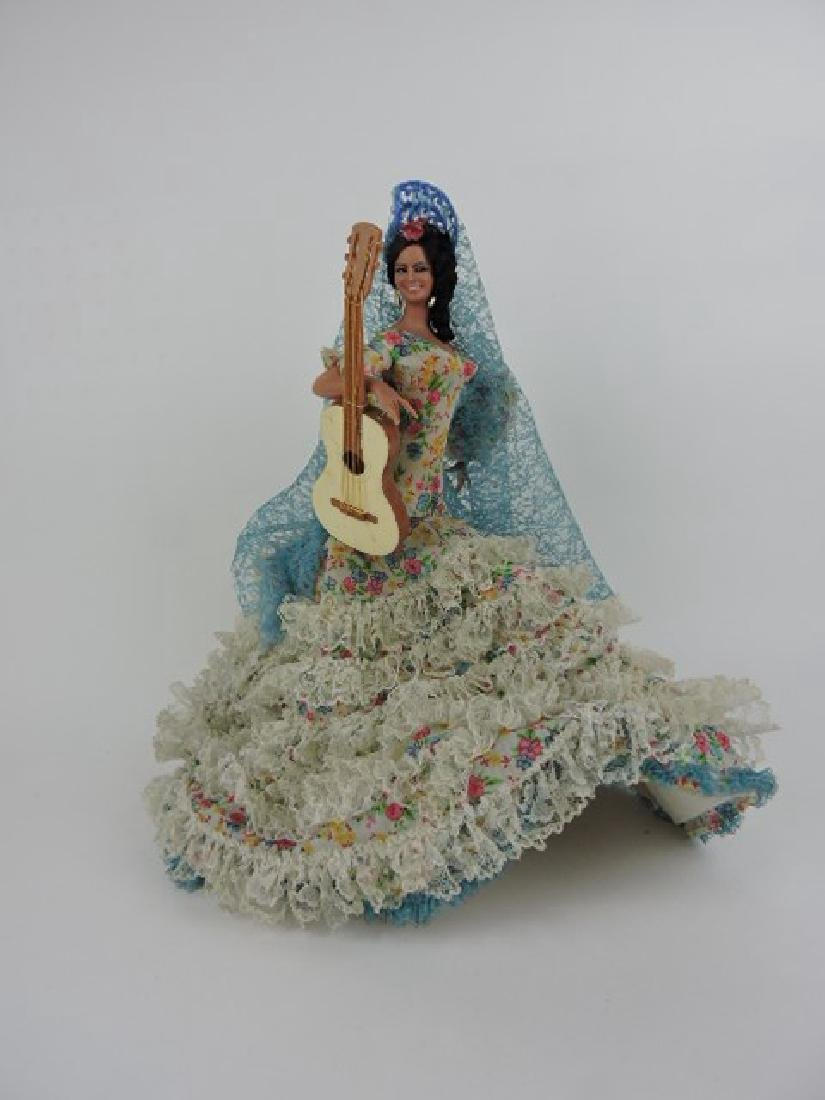 Hispanic lady doll with guitar