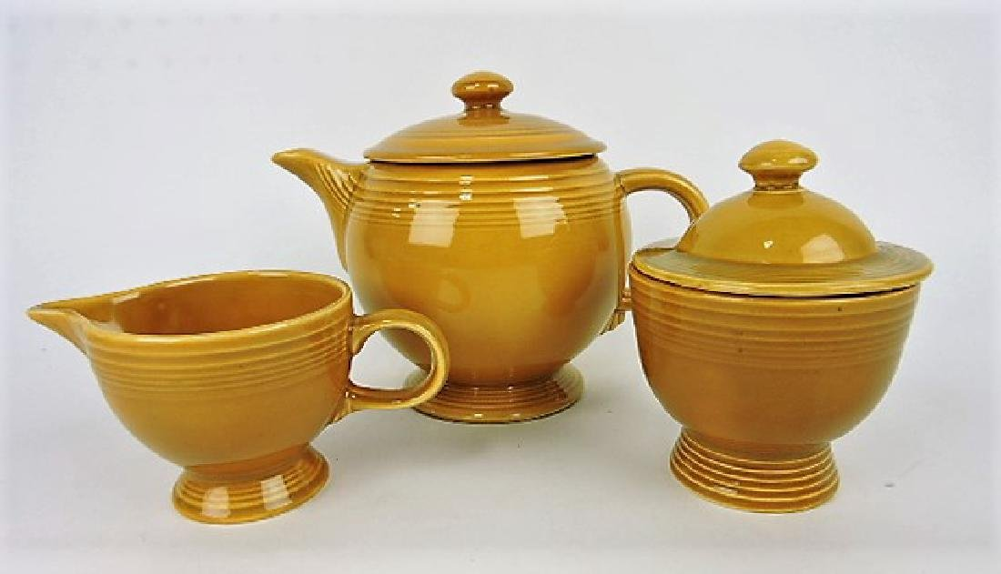 Fiesta Ironstone gold teapot, cream, and