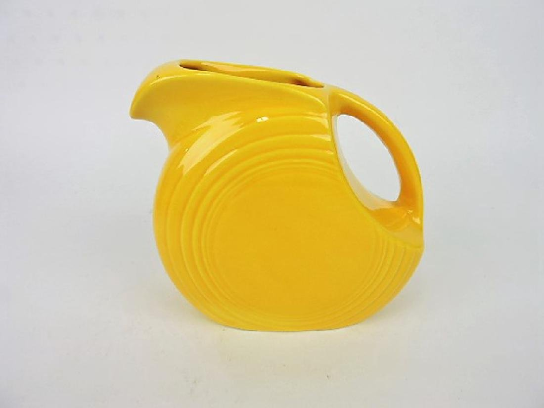 Fiesta disk juice pitcher, Harlequin yellow