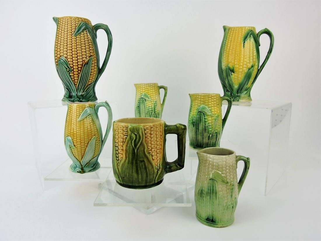 Majolica lot of 7 corn pitchers,
