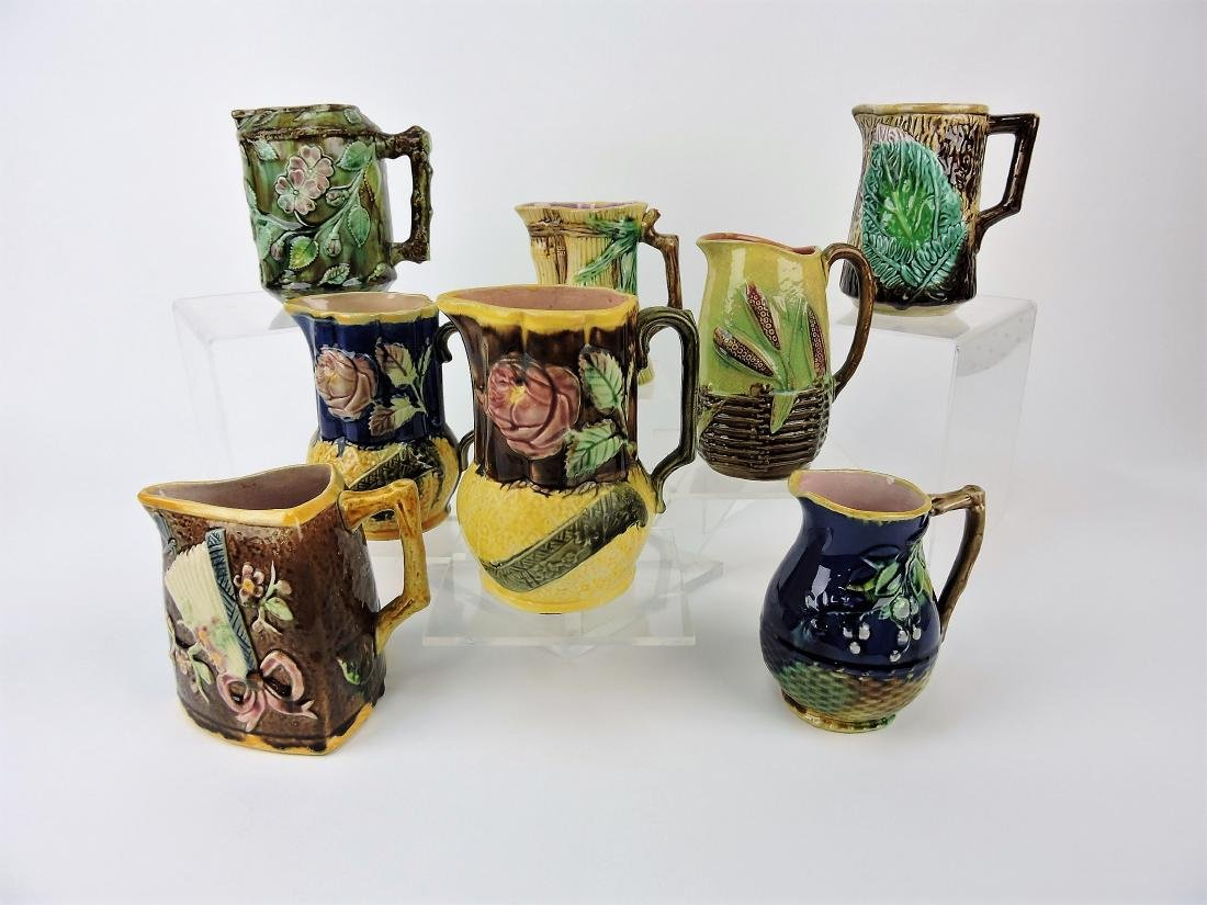 Majolica lot of 8 pitchers,