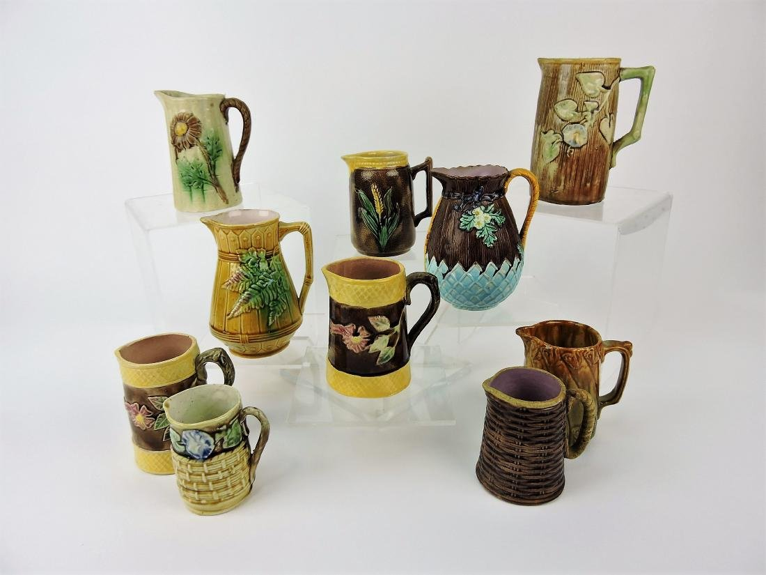 Majolica lot of 10 pitchers, 5 - 6""