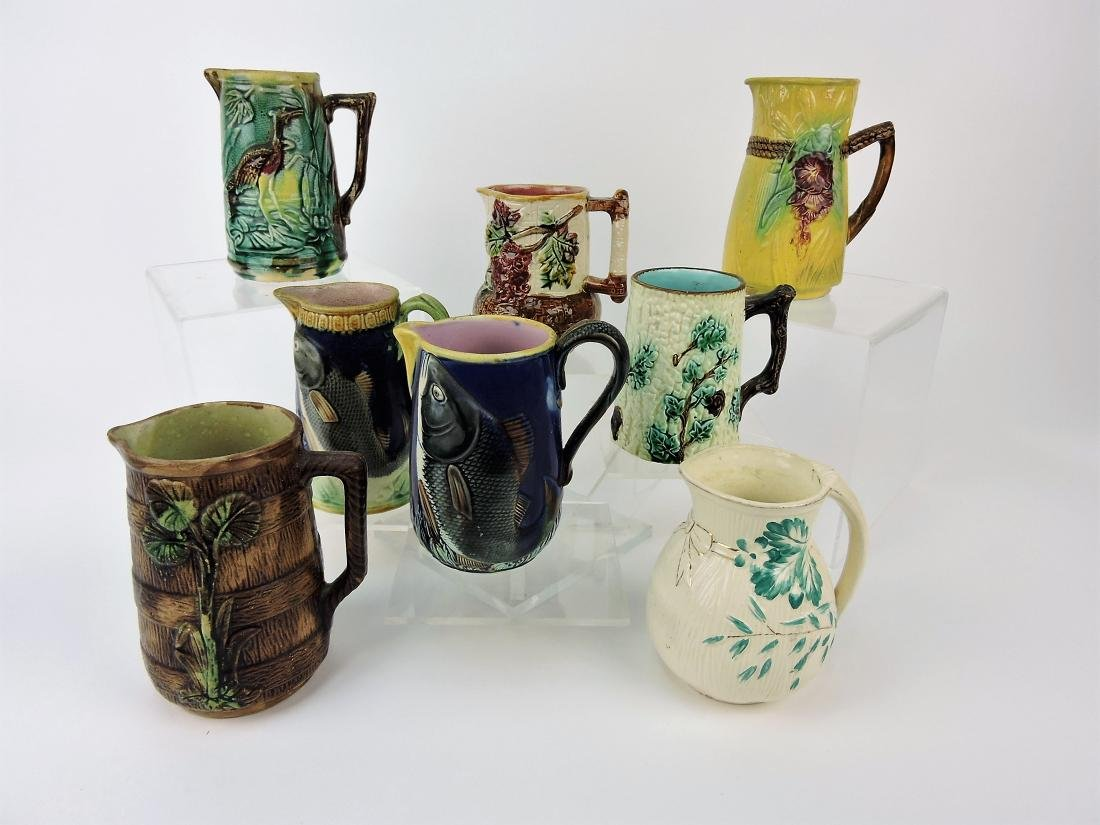 Majolica lot of 8 pitchers, 6""