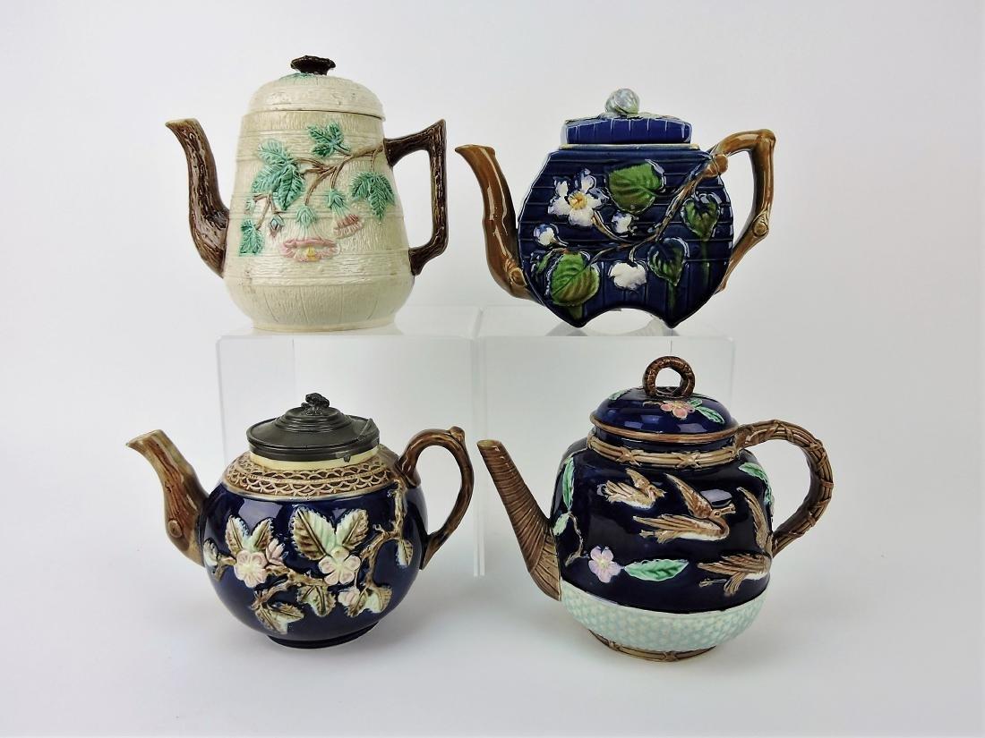 Majolica lot of 4 teapots,