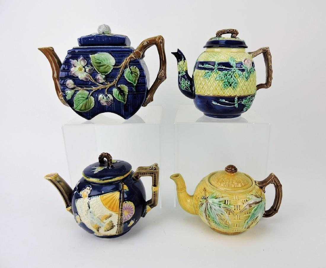 Majolica lot of 4 teapots, various
