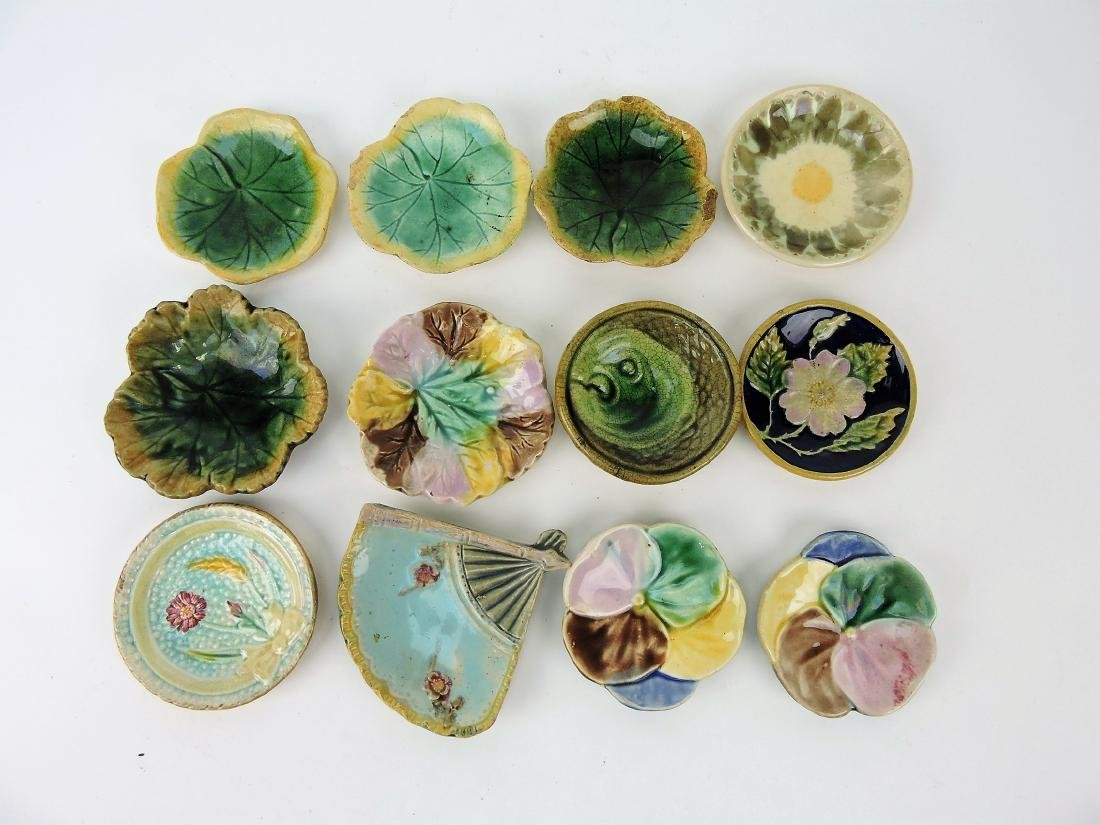 Majolica lot of 12 butter pats,
