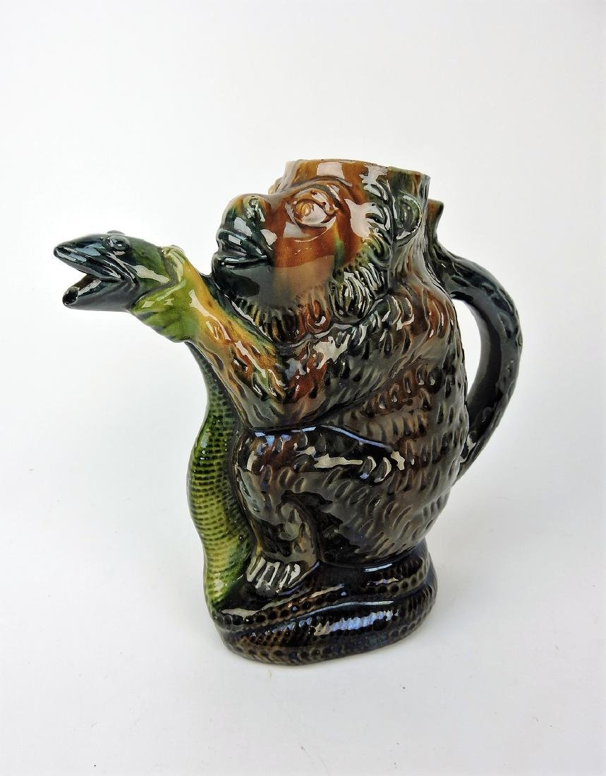 Majolica monkey with snake figural