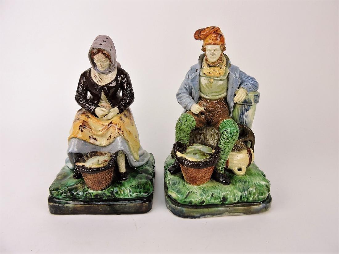 Pair of Majolica figures, fisherwoman