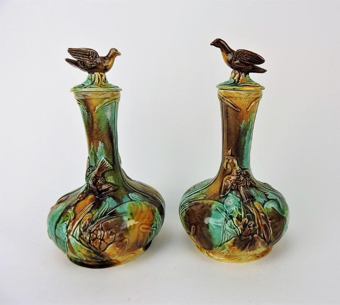 Majolica pair of water carafes with bird