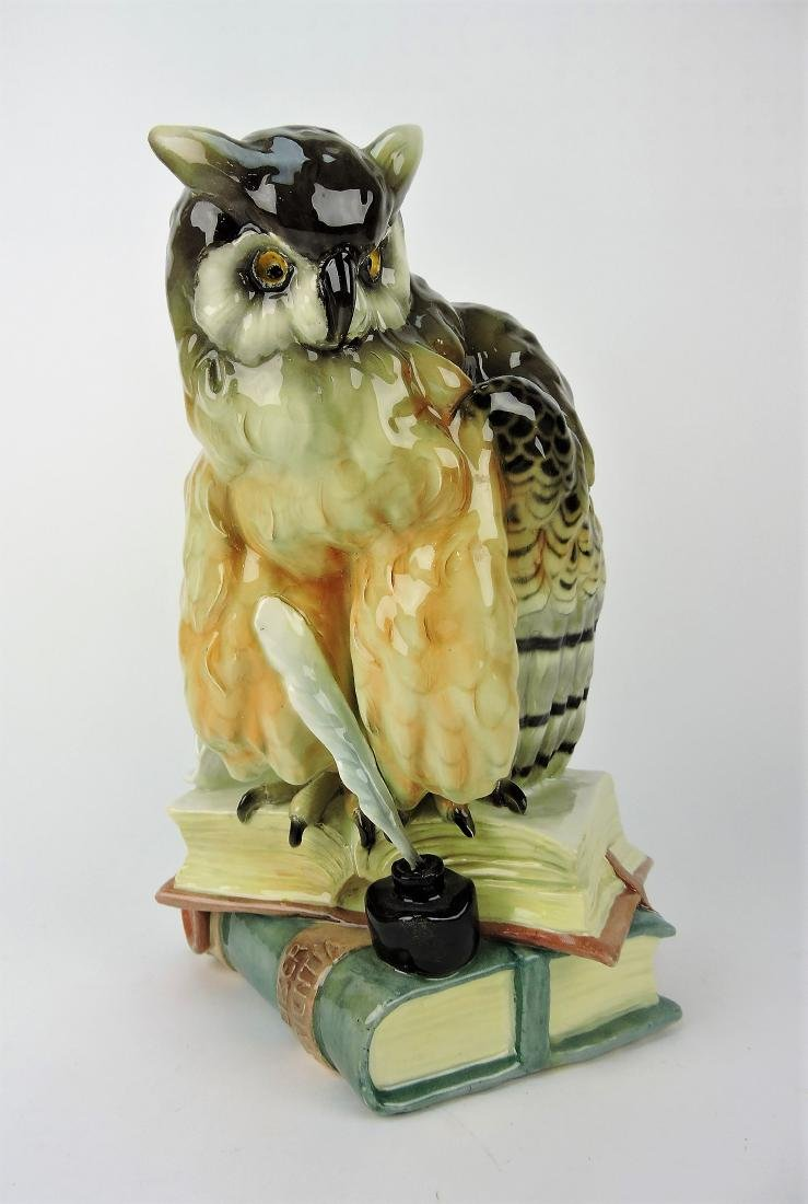 Majolica figure of wise owl atop books