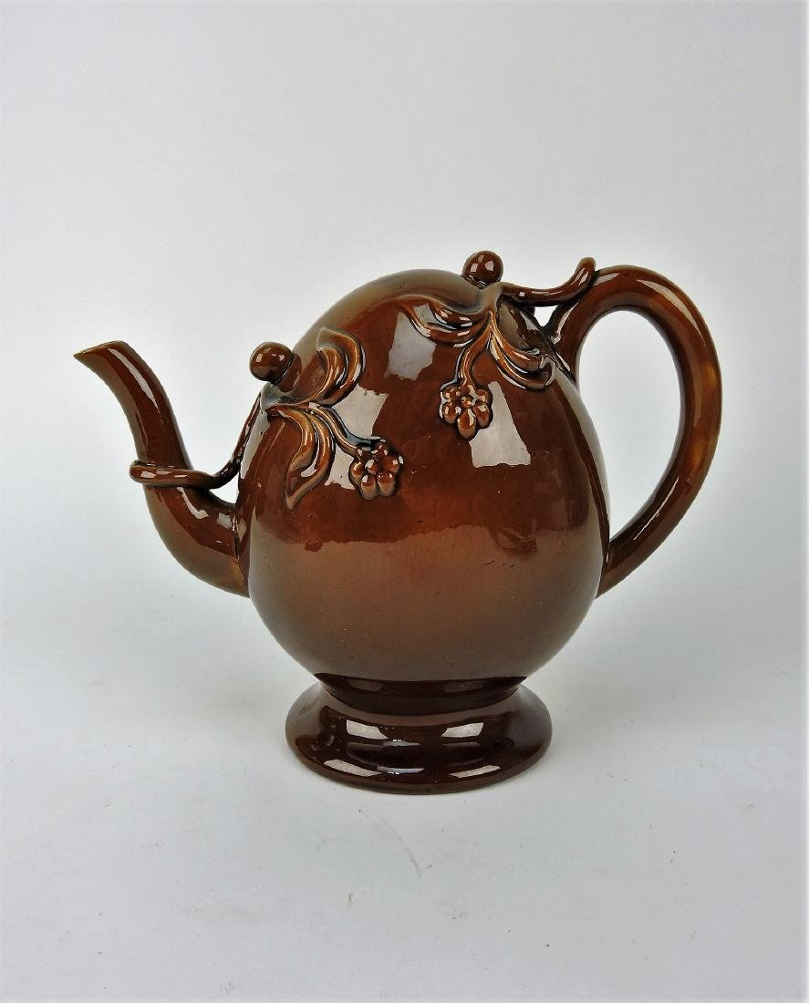 Majolica brown puzzle teapot, nick to