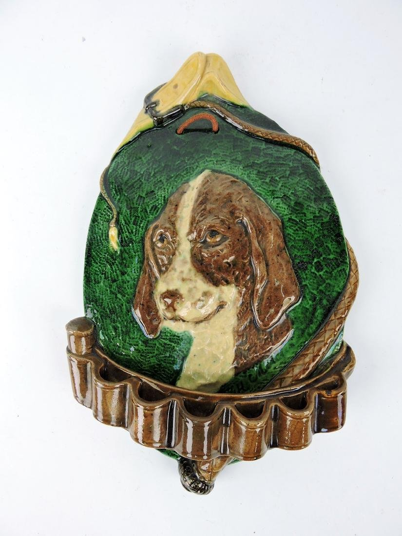 Majolica wall pipe rack with dog