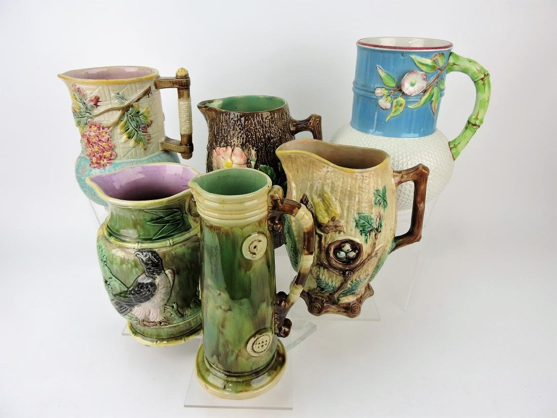 "Majolica lot of 6 9"" pitchers,"