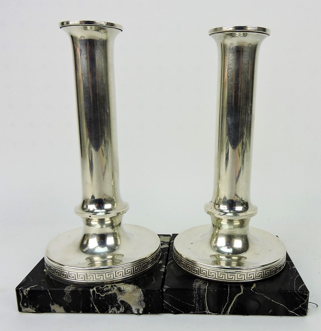 Pair of silver candle sticks with marble