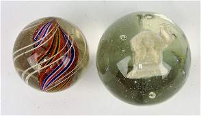 "Swirl and sulfide marbles; 1 1/4"","