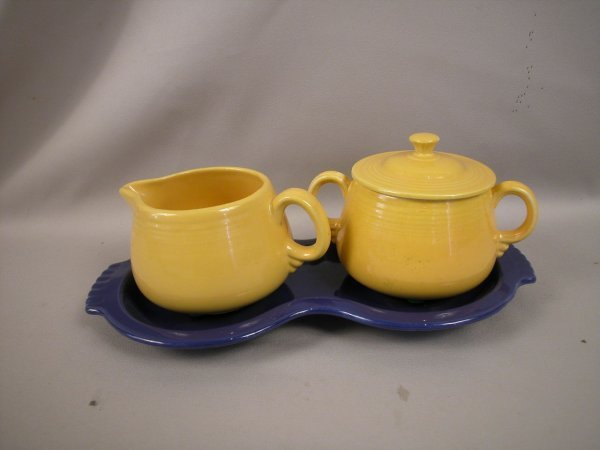 340: Fiesta individual yellow cream and sugar on cobalt