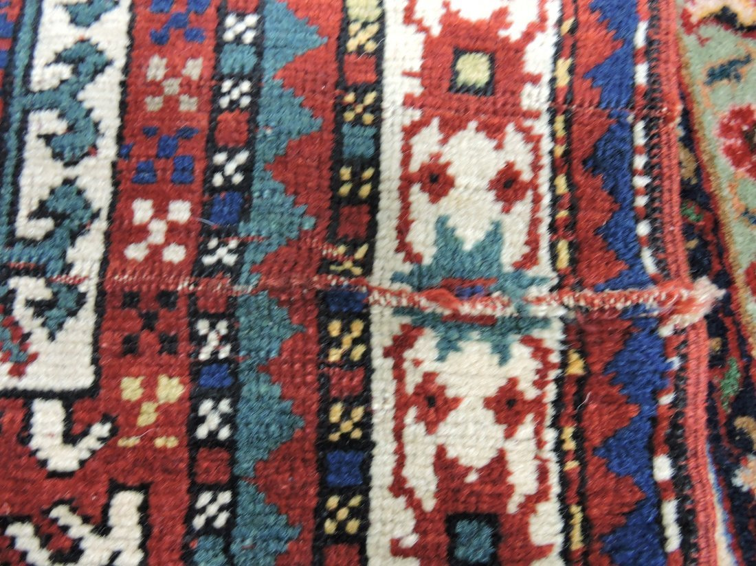 """Oriental rug 37"""" x 53"""", 7"""" repair - 4"""