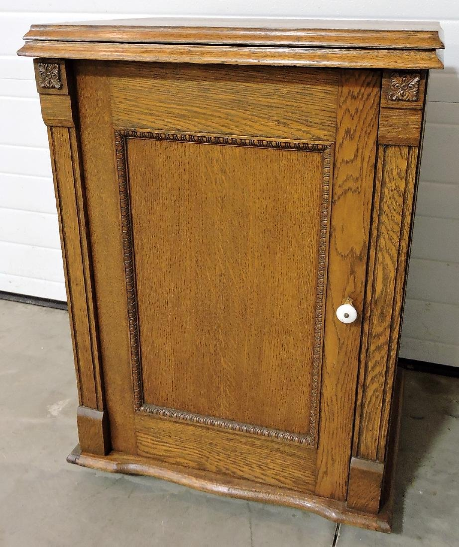 "Oak sewing machine cabinet, 31""h,"