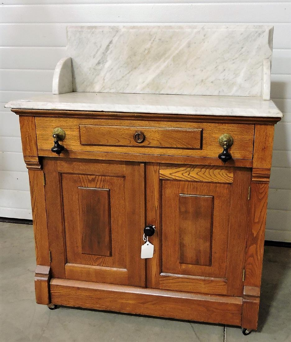 Walnut Victorian marble top commode,
