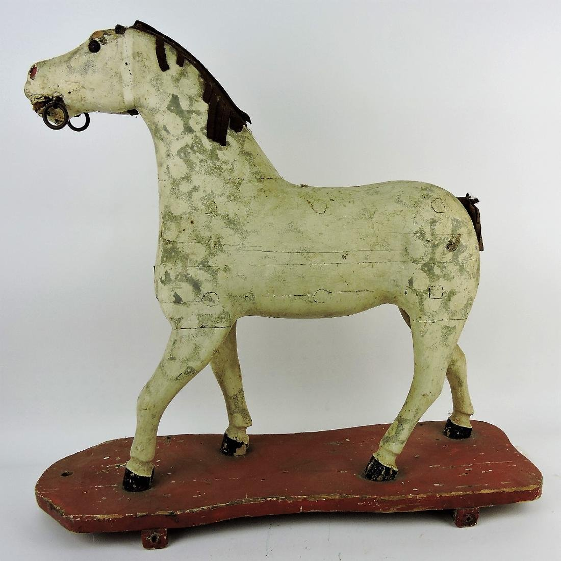 Early wooden carved horse pull