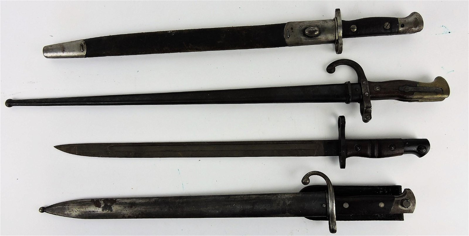 Bayonet lot of 4, three with scabbards,