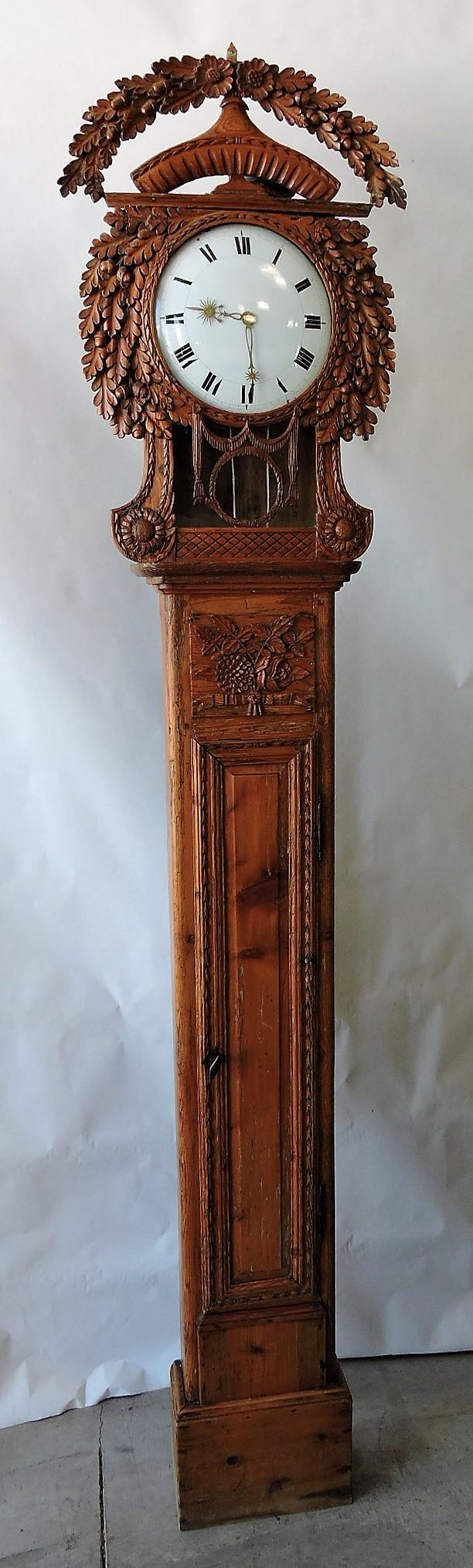 Pine tall case clock with carved oak