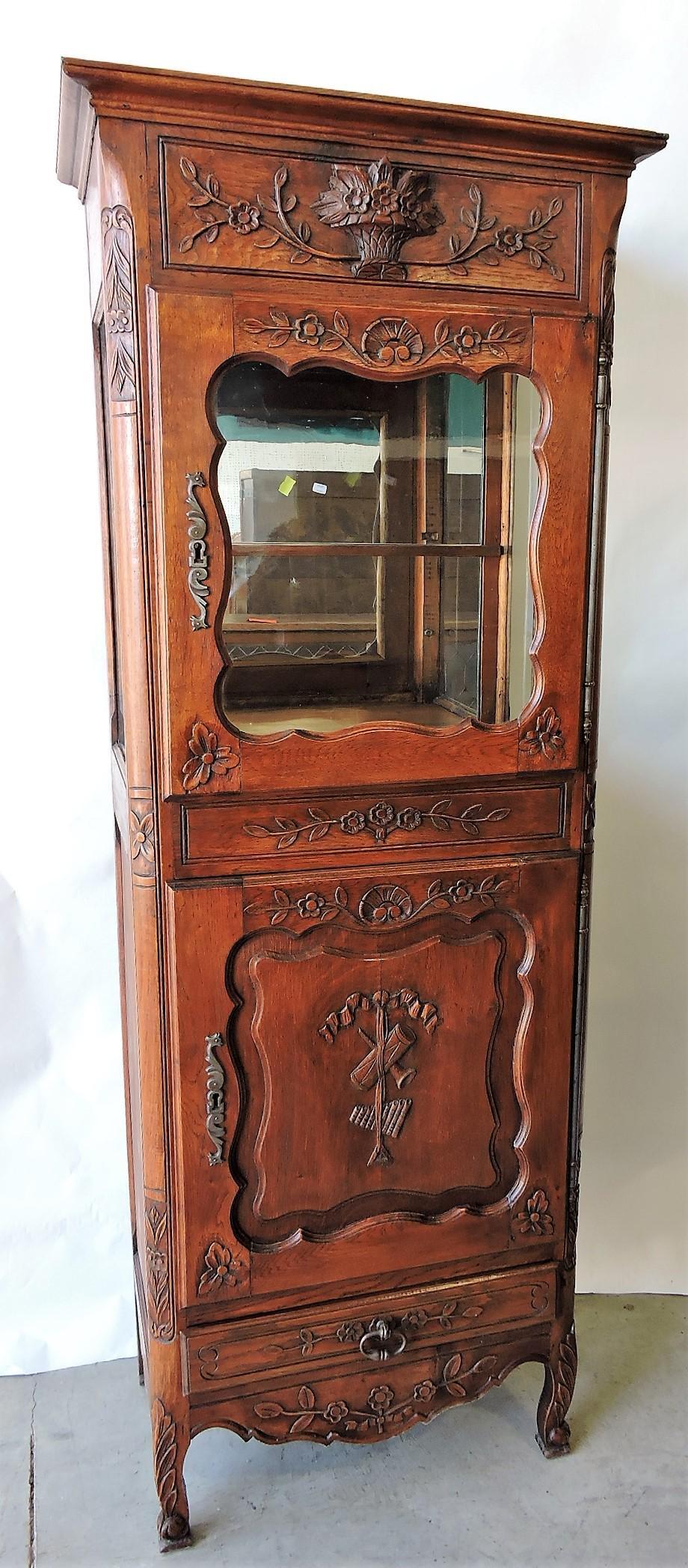 Oak carved display case with carved