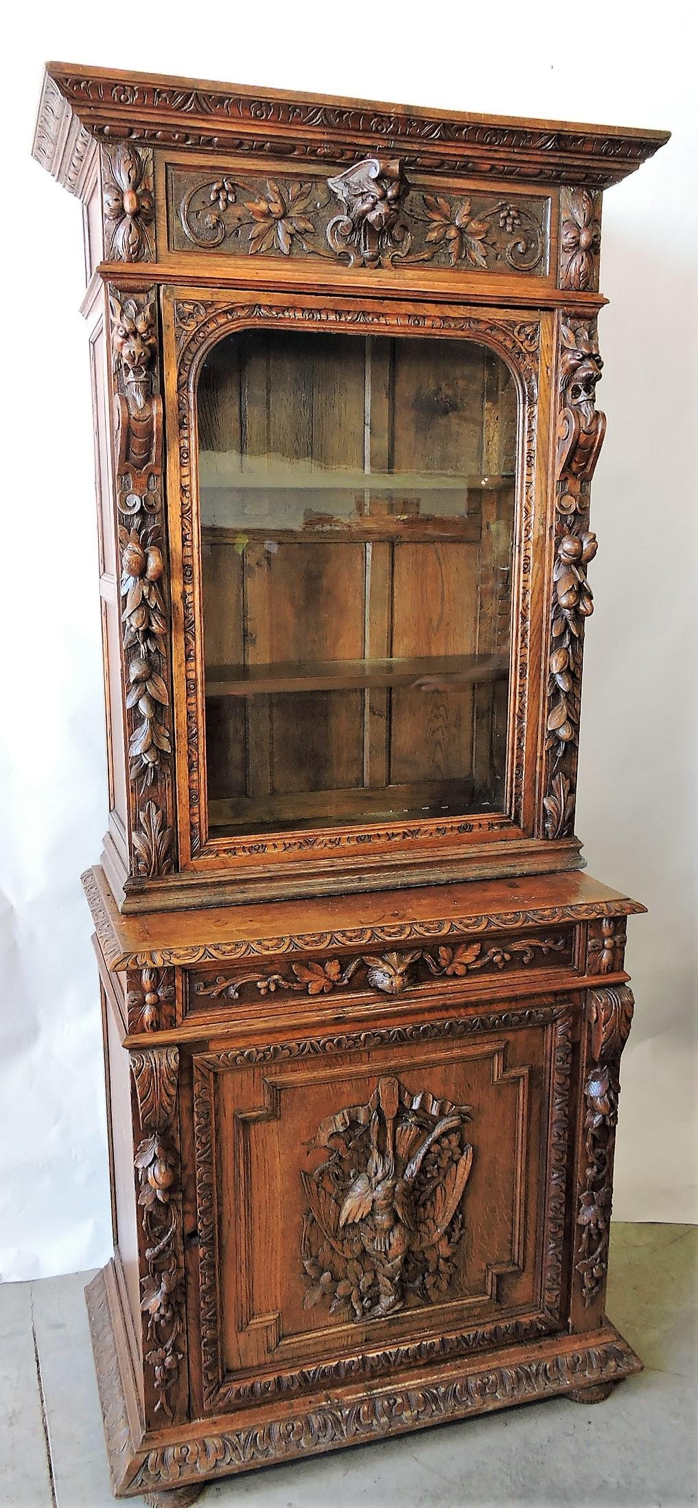 Oak carved two piece cabinet with