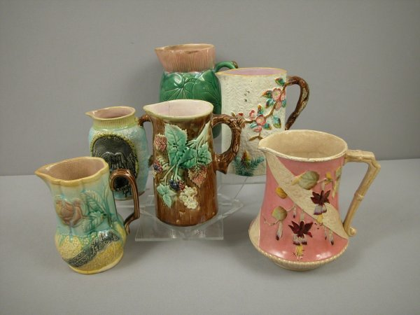 9: Majolica group of 6 pitchers, various condition