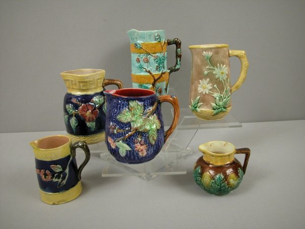 11: Majolica group of 6 pitcher and creamers, various c