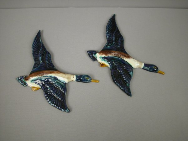 12: Majolica Pair of figural duck wall plaques with cob