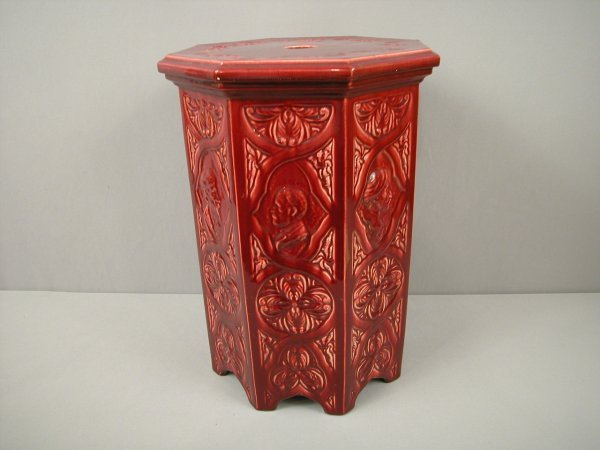17: Majolica red octagon garden seat with portraits on