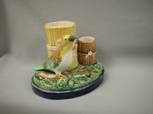 415: Majolica Figural vase with bird on branch with oak